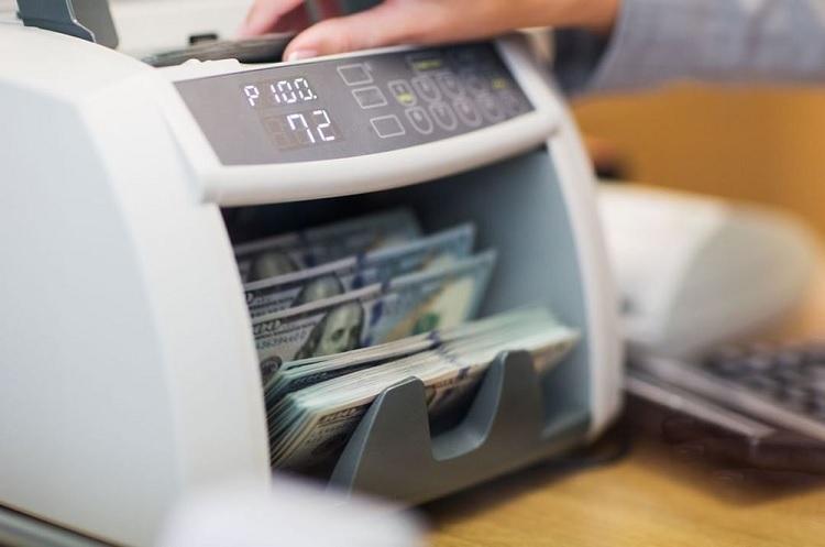 Nên chọn mua máy đếm tiền thông thường hay máy đếm tiền giả
